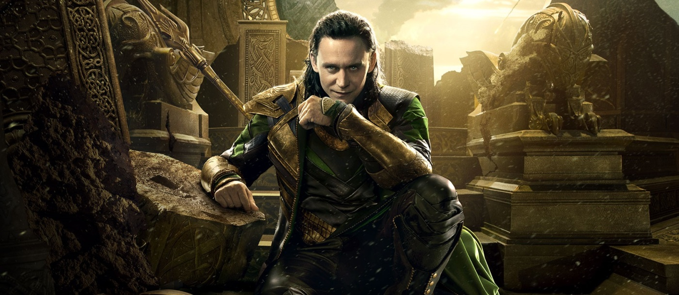 Loki seated in the ruins of Asguard palace, looking smug