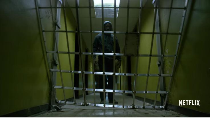 Luke Cage kicks down cage